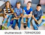 teens reading books   Shutterstock . vector #709409200