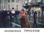 young man leading a protest... | Shutterstock . vector #709415548