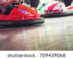 colorful electric bumper car in ... | Shutterstock . vector #709439068