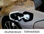 electric vehicle  ev  charging... | Shutterstock . vector #709444504
