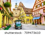 touristic retro car on... | Shutterstock . vector #709473610