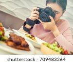 women hold a camera in a hand... | Shutterstock . vector #709483264