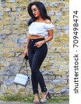 model against a brick wall... | Shutterstock . vector #709498474
