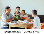 family with two kids painting... | Shutterstock . vector #709515748