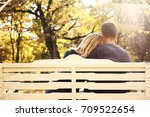 loving couple on a bench in a... | Shutterstock . vector #709522654