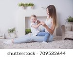 happy mother and child together | Shutterstock . vector #709532644