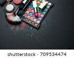 makeup brush and cosmetics on... | Shutterstock . vector #709534474