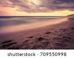 sunset over the beach in... | Shutterstock . vector #709550998