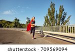 girl runner in a superhero... | Shutterstock . vector #709569094