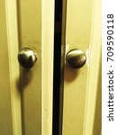 Small photo of Green door slightly ajar.
