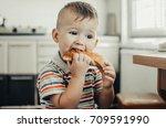 wonderful little child eating a ... | Shutterstock . vector #709591990
