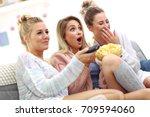 three beautiful young women... | Shutterstock . vector #709594060