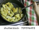 woman stir baked potatoes with... | Shutterstock . vector #709596493