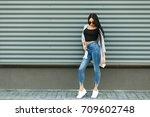 beautiful stylish woman in a... | Shutterstock . vector #709602748