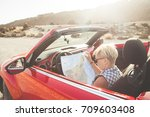 young pretty woman sees the map ... | Shutterstock . vector #709603408
