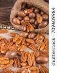Pecan Nuts On Wooden Background