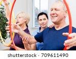 physio instructing senior man... | Shutterstock . vector #709611490