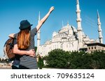 a couple of tourists a young... | Shutterstock . vector #709635124