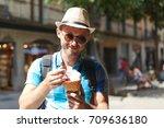 short bearded man enjoying ice... | Shutterstock . vector #709636180