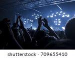 concert goers applauding inside ...   Shutterstock . vector #709655410