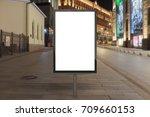 blank street billboard at night ...   Shutterstock . vector #709660153