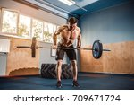 strong bearded tattooed man at... | Shutterstock . vector #709671724
