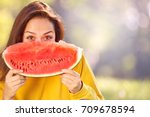 happy young woman eating... | Shutterstock . vector #709678594