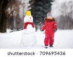 little boy in red winter... | Shutterstock . vector #709695436