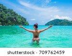 backside woman in bikini... | Shutterstock . vector #709762459