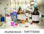 Small photo of Scientists are investigating the acidity of a chemical by litmus paper in a chemistry lab.