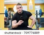 handsome guy text messaging on... | Shutterstock . vector #709776889