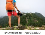 young woman hiker with camera... | Shutterstock . vector #709783030