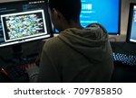 hacker man working on computer | Shutterstock . vector #709785850