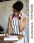 adult woman receiving order... | Shutterstock . vector #709796488