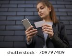 selective focus on smartphone... | Shutterstock . vector #709797409