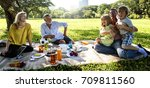 family picnic outdoors... | Shutterstock . vector #709811560