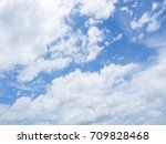 soft white clouds against blue... | Shutterstock . vector #709828468