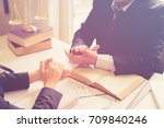 client and lawyer have a sit... | Shutterstock . vector #709840246