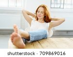 young woman taking time out to... | Shutterstock . vector #709869016