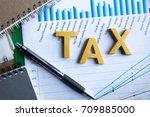 tax concept.word tax put on... | Shutterstock . vector #709885000
