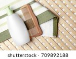 bottle with lotion and comb on... | Shutterstock . vector #709892188