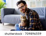 Stock photo man with a cat 709896559