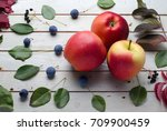 three red apples on a wooden... | Shutterstock . vector #709900459