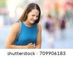 single woman suffering belly... | Shutterstock . vector #709906183