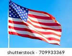 waving flag in the blue sky ... | Shutterstock . vector #709933369