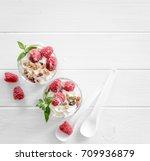 healthy dessert. granola with... | Shutterstock . vector #709936879