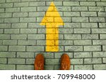 person's feet in suede shoes is ...   Shutterstock . vector #709948000