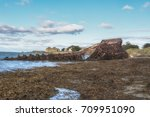 rusty wrecked ship in the... | Shutterstock . vector #709951090