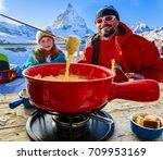 swiss fondue dinner   family... | Shutterstock . vector #709953169
