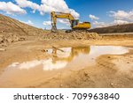 large excavator worked on a site | Shutterstock . vector #709963840